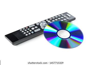 DVD, CD-ROM or Blu-Ray disc with tv or disc player remote control on white background. Home theatre movie or series concept.