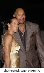 """DWAYNE """"THE ROCK"""" JOHNSON & wife DANY GARCIA at the world premiere, in Hollywood, of his new movie Walking Tall. March 29, 2004"""