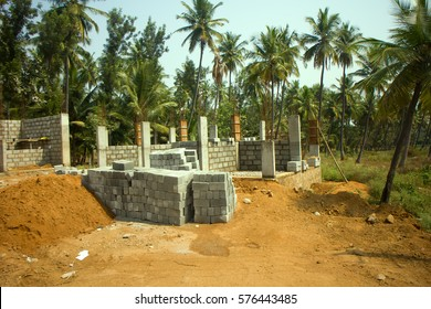 Dwelling in Indian province. Construction of new brick house in palm grove, private-type dwelling rural architecture