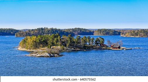 Dwellings islands on Stockholm archipelago in Baltic sea at sunny morning
