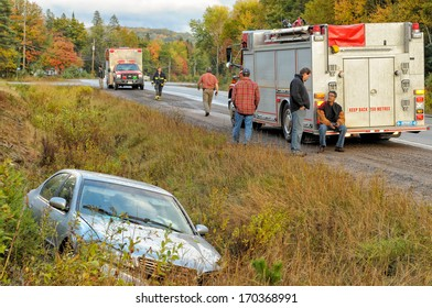 DWIGHT, ONTARIO - OCTOBER 4, 2009: Firemen and paramedics at the scene of an automobile accident