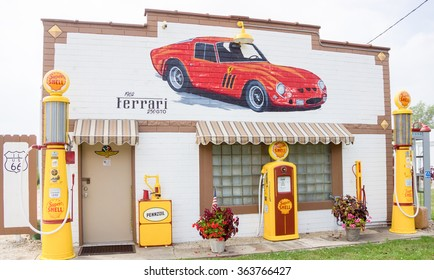 DWIGHT, USA - AUGUST 31; Landmark restored Route 66 garage at Dwight with old Shell pumps Pennzoil oil pump and Ferrari mural on facade on August 31, 2015 in Dwight, Illinois, USA
