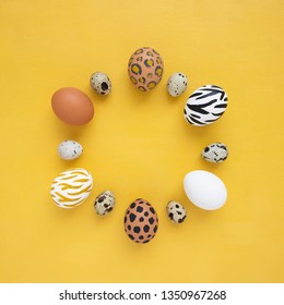 Dyed Easter eggs on yellow background. Creative animal pattern. Flay lay. Copy space.