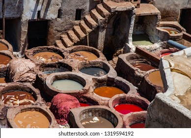 Dyer's vats and workshop in Fez, Marocco. Colorful vats. Famouse tanneru in Marocco.