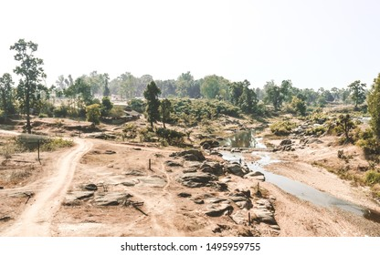 Dying rivers of a Narmada tributary in Madhya Pradesh on a scorching hot April afternoon. Dry land depicting a drought. A typical natural arid climate scenery in the rural India in a Hot Summer Day.