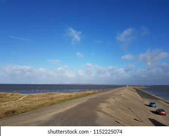 Dyke into the sea at Ouddorp in the Netherlands at the shore of the North Sea.