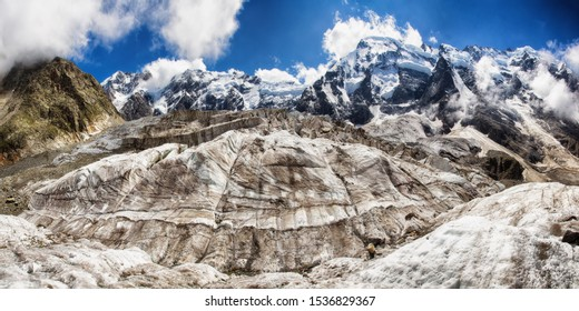 Dykh-Tau - the second highest mountain in Europe, after Mount Elbrus. View of the glacier Kundum-Mizhirgi. The Northern wall of the Mijirghi massif Caucasus, Bezengi region, Kabardino-Balkaria, Russia