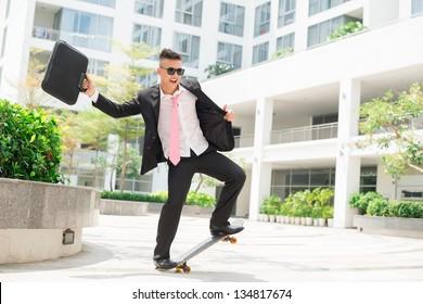 Dynamic businessman with positive attitude towards life balancing on a skateboard