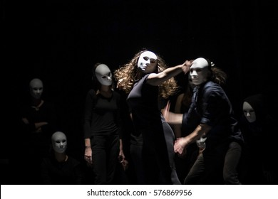 dynamic dance drama on stage in theater- theater group on stage