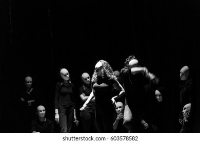 dynamic dance drama on stage in theater- theater group on stage - Masks on stage in theater