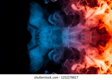 A dynamic explosion of puffs of smoke of light blue orange and red colors swirl on a black background with tongues of flame an isolated pattern in the form of a medusa.