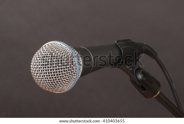 Dynamic microphone on charcoal background ready for use.