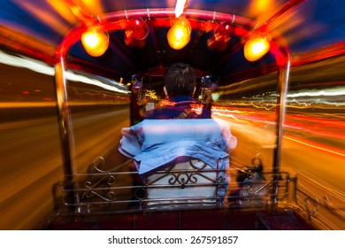 Dynamic perspective and long time exposure inside a Tuk tuk vehicle in Bangkok, Thailand