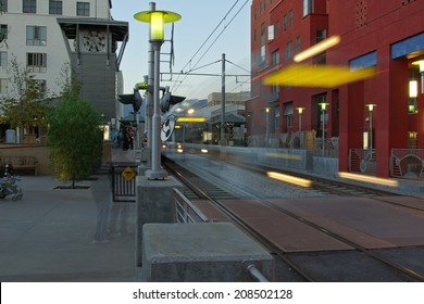 Dynamic scene at the 'Del Mar' train station (part of the Gold Line) in Pasadena, California. The Gold Line joins two light rail lines  and a subway that crisscross portions of Los Angeles County.