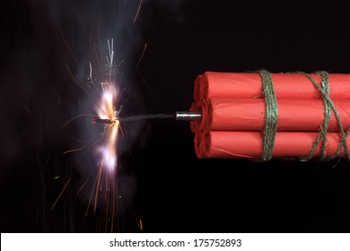 Dynamite checkers associated explosive with a burning fuse.