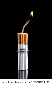 Dynamite made from cigarettes shows danger of smoking. Stop smoking concept.