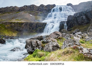 Dynjandi waterfall in the westfjords of Iceland. One of the most beautiful waterfalls in the whole Iceland with nice boulders in the front of photo. It is actually the cascade of waterfalls.