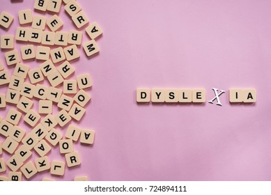 dyslexia concept - alphabet letters on pink background