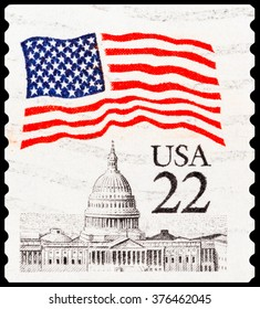 DZERZHINSK, RUSSIA - FEBRUARY 04, 2016: A postage stamp of USA shows usa capitol and flag, circa 1985