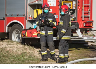 DZIESLAW, POLAND - APRIL 6, 20209 - Firefighters with face msk due to Covid-19 during the fire extinguishing action.