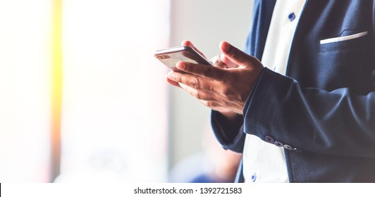 e commerce online on mobile phone screen with businessman work in the office, The media reaches the operational guidelines,for panoramic banner background with copy space