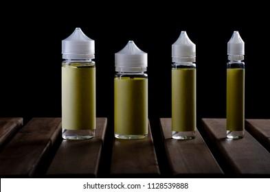 e liquid chubby  bottle 120ml, 60ml, 30ml isolated over a black background. vape bottle.