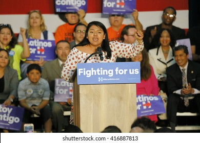 E LOS ANGELES COLLEGE, MONTEREY PARK, CA - MAY 5, 2016 - Cinco de Mayo, Hispanic girl introduces Secretary State Hillary Clinton who Addresses Mostly Latino Presidential Rally