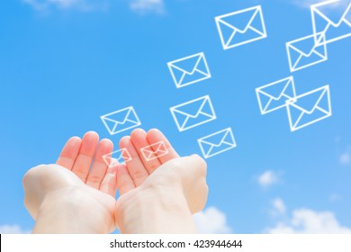 e mail icon and blue sky background