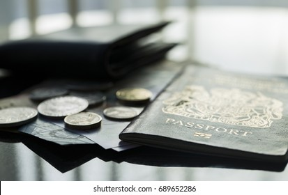 E Passport on a table next to a wallet and money, concept for travel and vacation