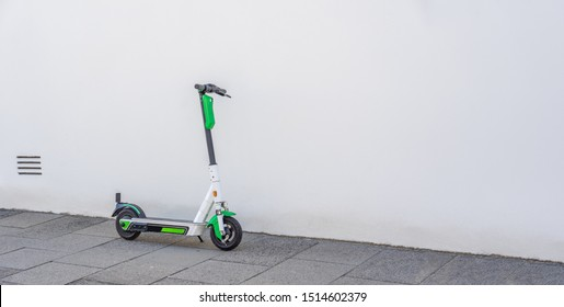 E Scooter in front of a white wall