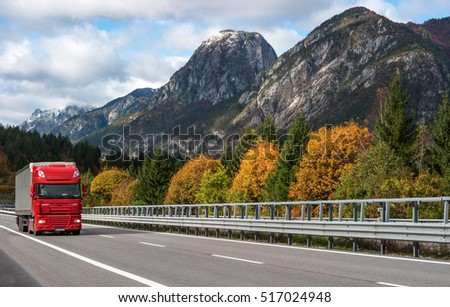 E45 Motorway, Austria - October 21, 2016: Red truck driving on the highway in the Alps.