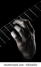 E7#9, dominant seventh augmented ninth chord aka Hendrix chord or Purple Haze chord on on classical guitar, toned monochrome image