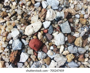 Each of the colorful rocks on the seashore.