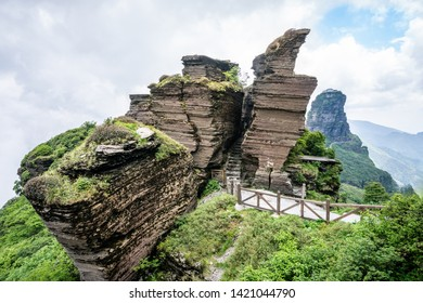 Eagle beak rock formation in Fanjing mountain with view of the new golden summit in background in Guizhou China