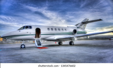 Eagle, Colorado, USA- March 17,2015-A Hawker 800 Private Jet Airplane parked on the ramp of the Eagle-Vail Airport waits for its passengers.