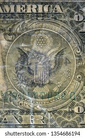 The Eagle ensign, highly magnified surface of used 1 dollar banknote with visible details of cotton fiber paper, with all flaws, watermarks and traces of usage.