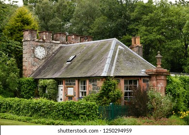 Eagle Lodge, Scottish Borders, Scotland, UK - June 19, 2018: West Clock Lodge coach house in Sheriffmoor Plantation Forest at Eagle Lodge Scottish Borders Scotland UK with ivy and clock chimney
