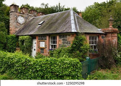 Eagle Lodge, Scottish Borders, Scotland, UK - June 19, 2018: West Clock Lodge coach house in Sheriffmoor Plantation Forest at Eagle Lodge Scottish Borders Scotland UK with ivy and clock on chimney