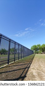 Eagle Pass, Texas - April 7, 2019 Famous Border Wall at Eagle Pass, TX during a sunny, calm, pleasant day.  The wall is constructed of steel, metal, concrete and is over ten feet tall.