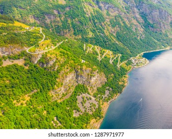 Eagle road winding in mountains from village Geiranger to Ornesvingen viewing point More og Romsdal county, Norway.