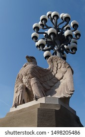 Eagle statue with ornate street light behind it on Market Street Bridge in Philadelphia, Pennsylvania, USA
