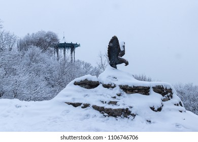 Eagle statue in snow (Eagle is emblem of Pyatigorsk). On the back the Chinese Arbor, one of the Pyatigorsk sight. Pyatigorsk, Northern Caucasus, Russia.