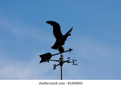 Eagle weather vane in a beautiful blue sky