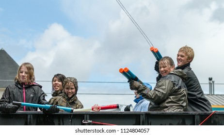 EAGLE/IDAHO - JUNE 9: Children squirting the crowd during th eagle fun days water parade in Eagle, Idaho