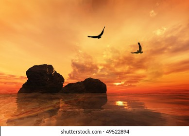 Eagles flying over rocks with a beautiful sunset
