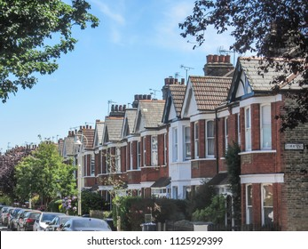 EALING, LONDON- JULY, 2018: A row of residential terraced houses in Ealing, west London