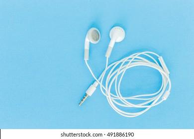 ear buds or earphones on green background