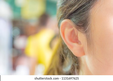 Ear is close-up. / Ear of women or ear of girl.