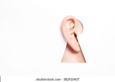 Ear in keyhole. International Ear Care Day. World Deaf Day. International Week of the Deaf