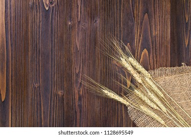 Ear of paddy on wooden table background.